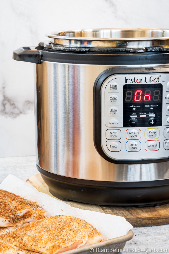 Instant Pot on the counter with Chicken Thighs
