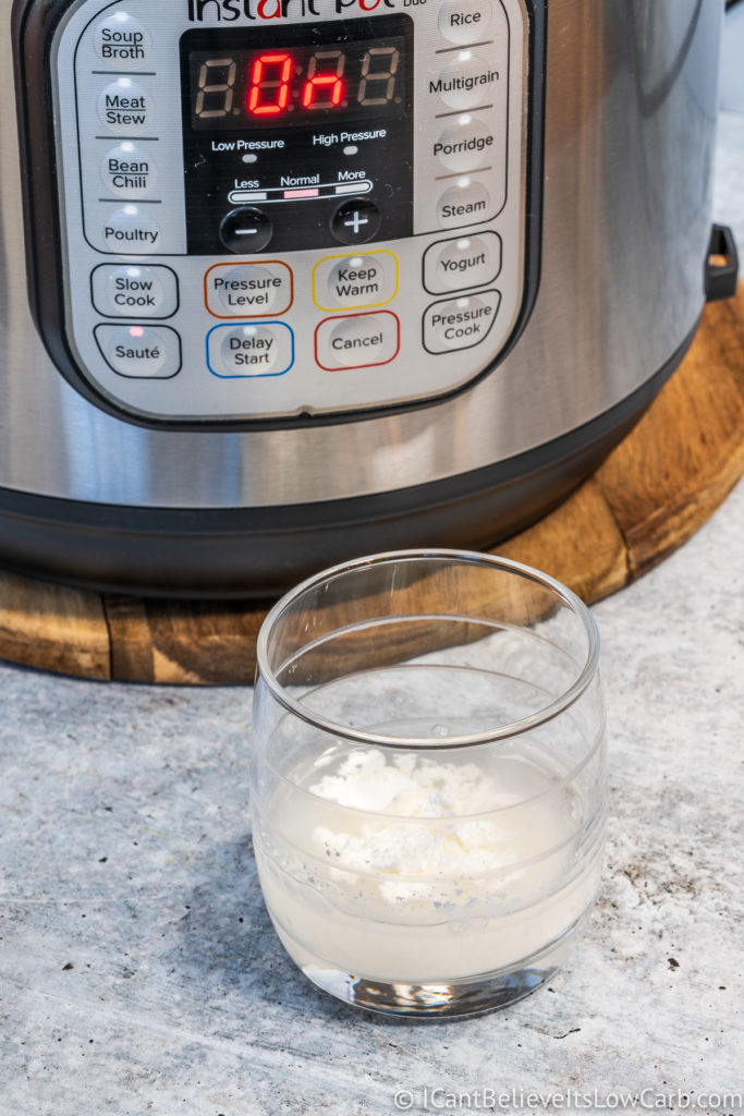 mixing cornstarch and water in a glass