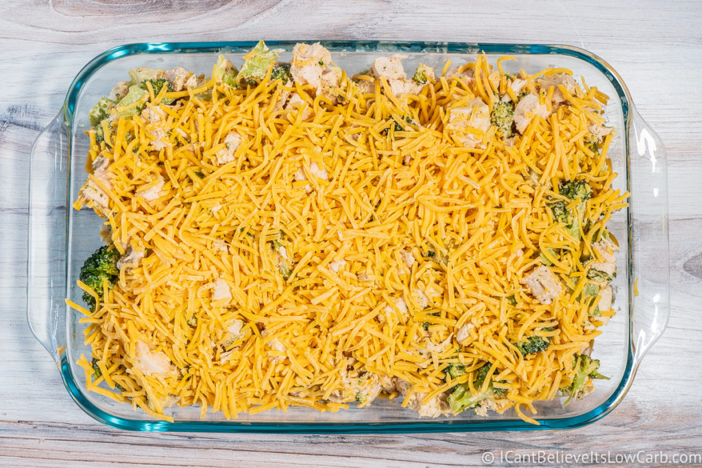 Covering Chicken Casserole with cheese
