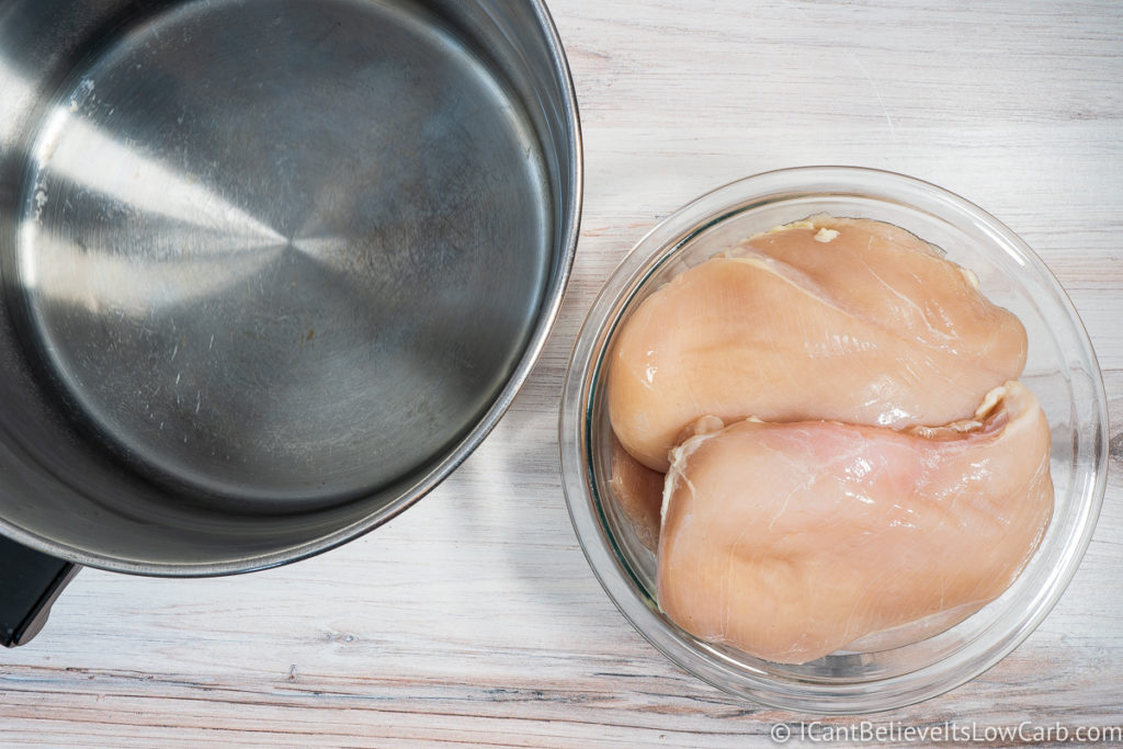 Raw Chicken and a pot of water