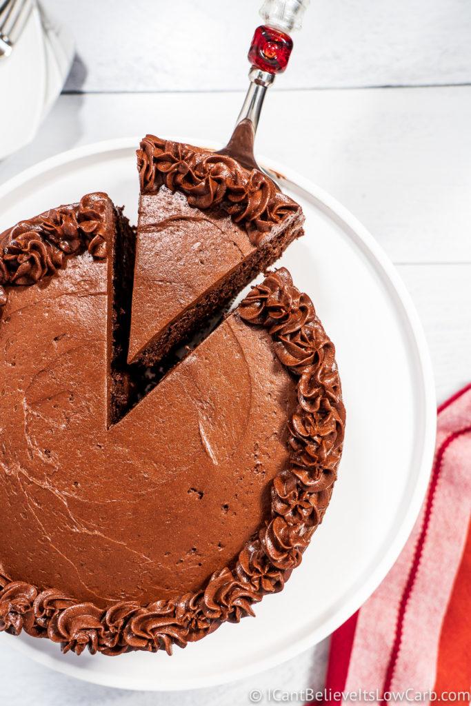 Taking slice of Keto Chocolate Cake