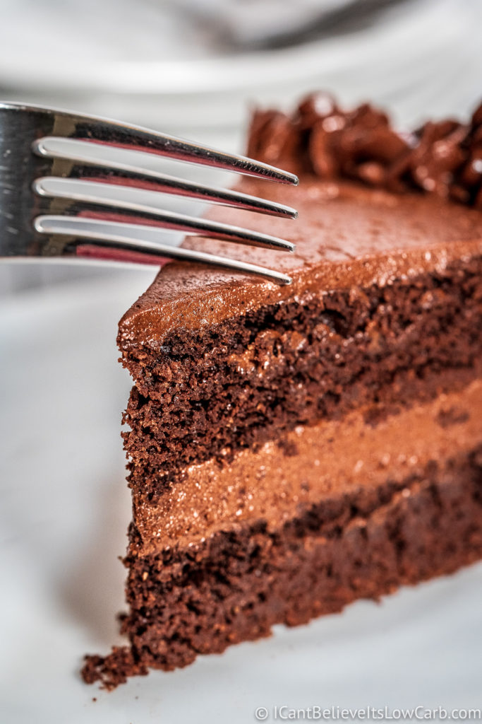 Cutting Keto Chocolate Cake with a fork