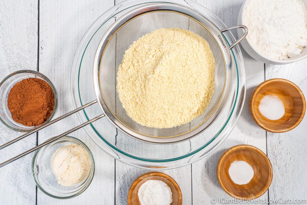 Adding almond flour to bowl