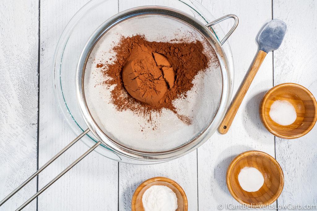 adding cocoa powder to bowl