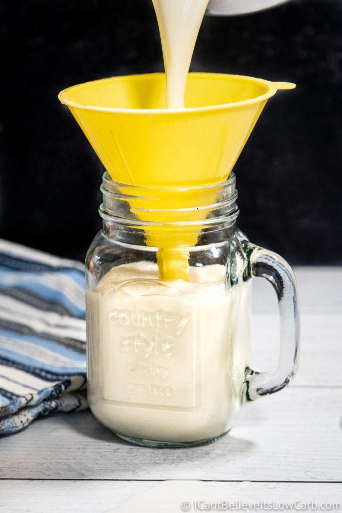pouring keto coffee creamer through a syphon