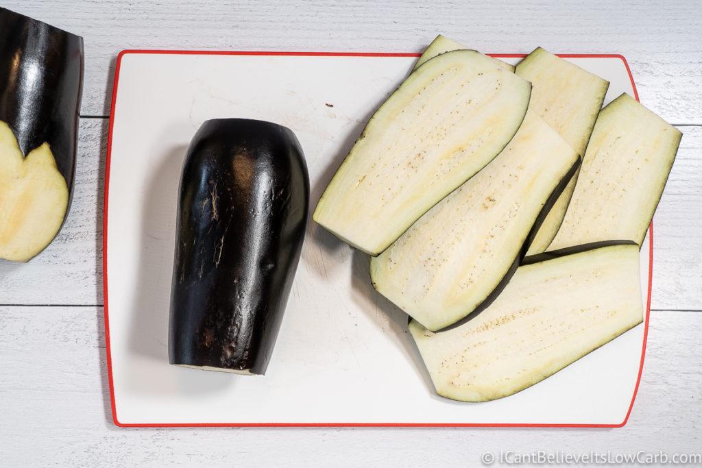 Eggplant sliced on cutting board