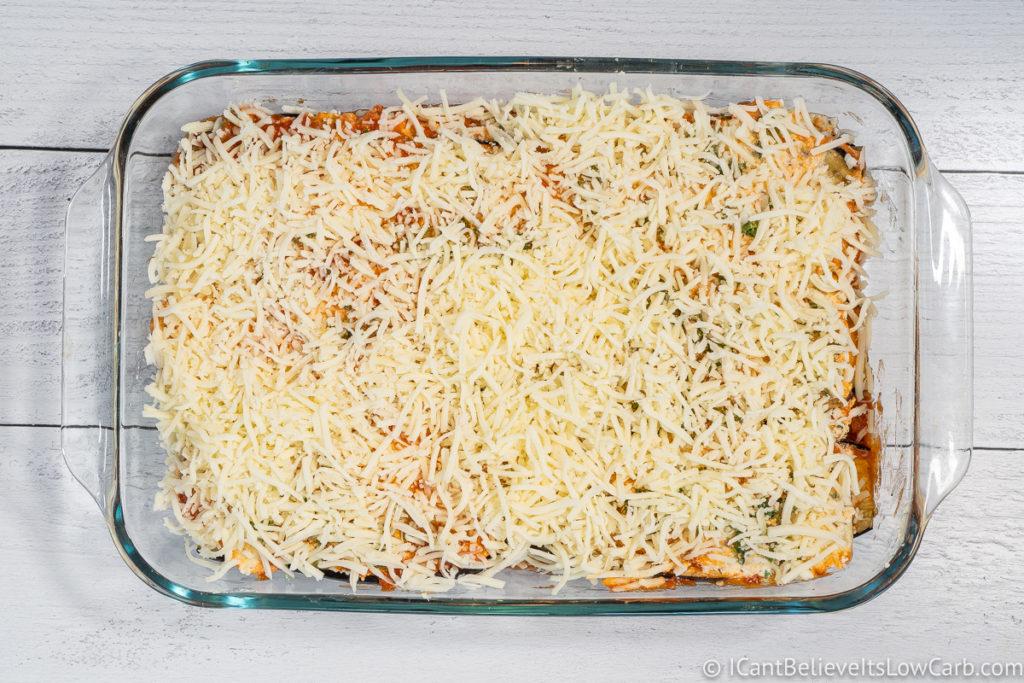 Covering Eggplant Lasagna with mozzarella cheese