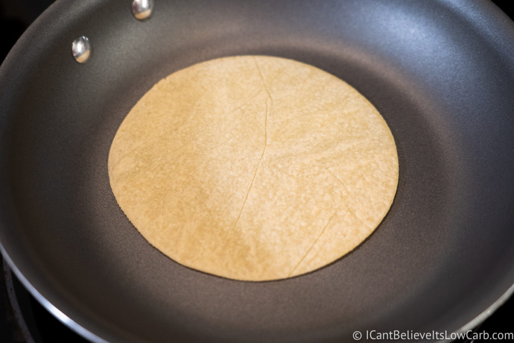 Keto Tortilla cooking in a pan