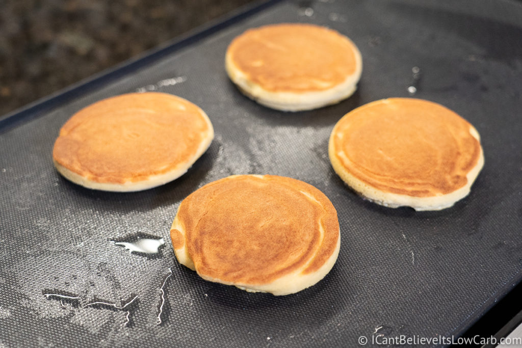 Cooked Coconut Flour Pancakes on the griddle
