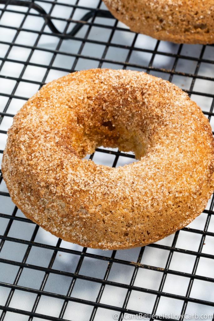 Low Carb Donuts coating in cinnamon sugar