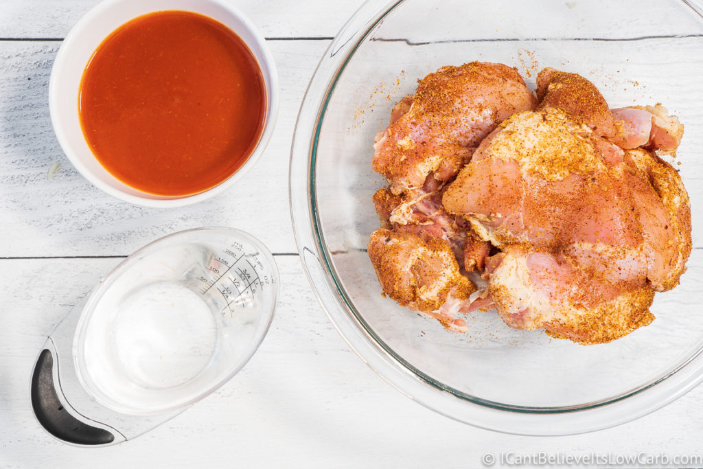 chicken in bowl and enchilada sauce