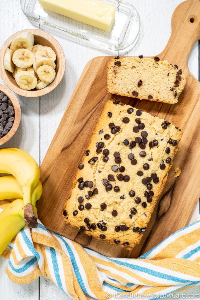 Keto Banana Bread on a cutting board with chocolate chips