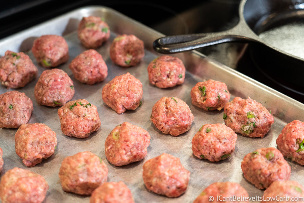 Raw meatballs on a baking tray