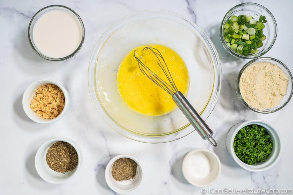 mixing eggs for Keto Meatballs