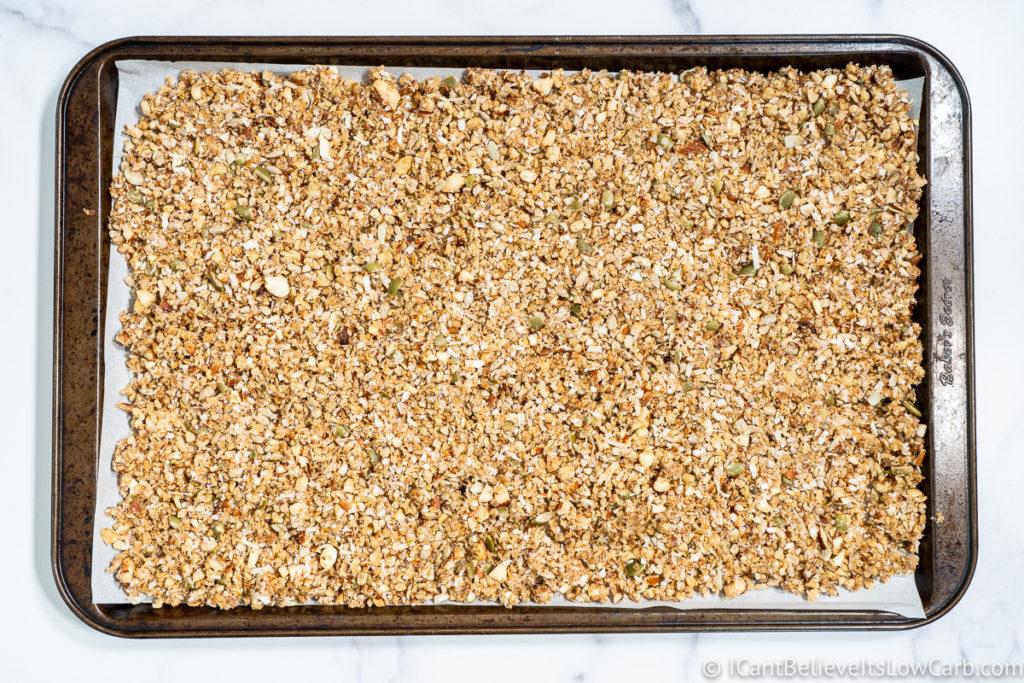 laying out granola mix on baking sheet