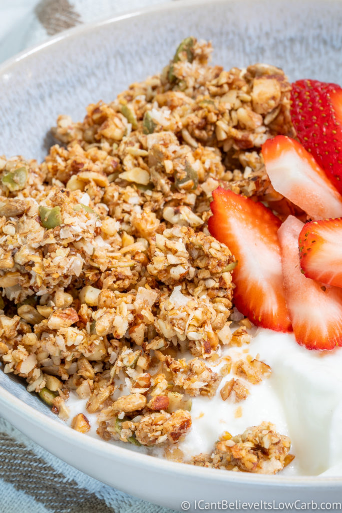 Low Carb Granola clusters in a bowl with yogurt and strawberries