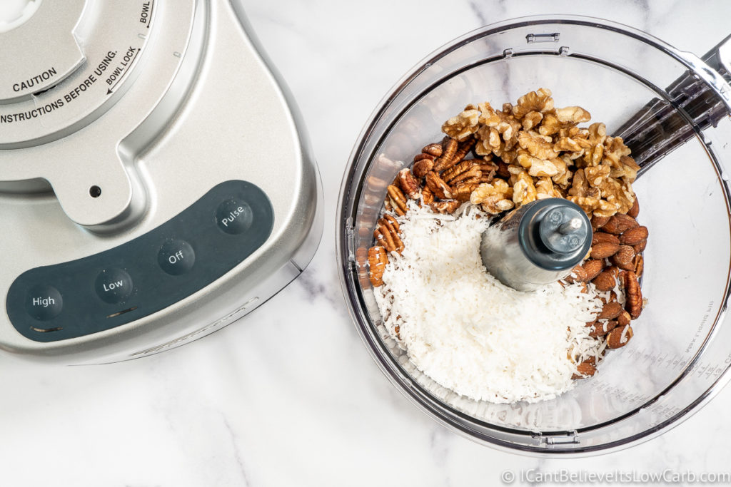 adding shaved coconut to the blender
