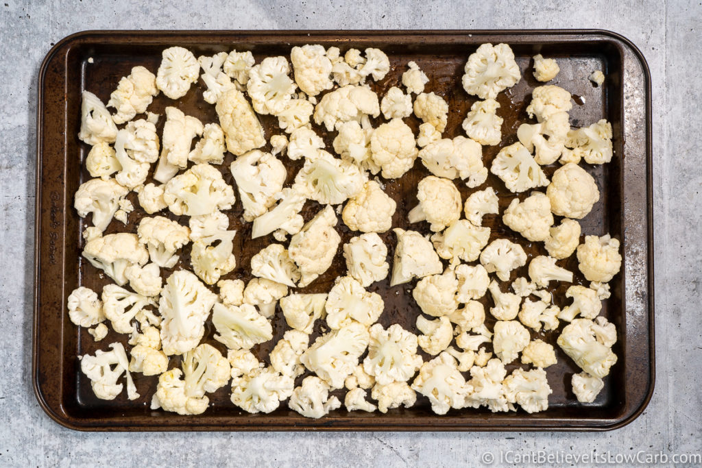 Cauliflower on a baking tray covered in olive oil