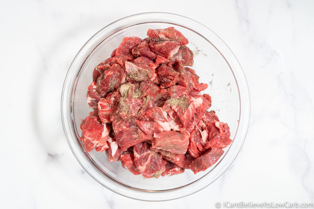 mixing in the salt and pepper with the beef