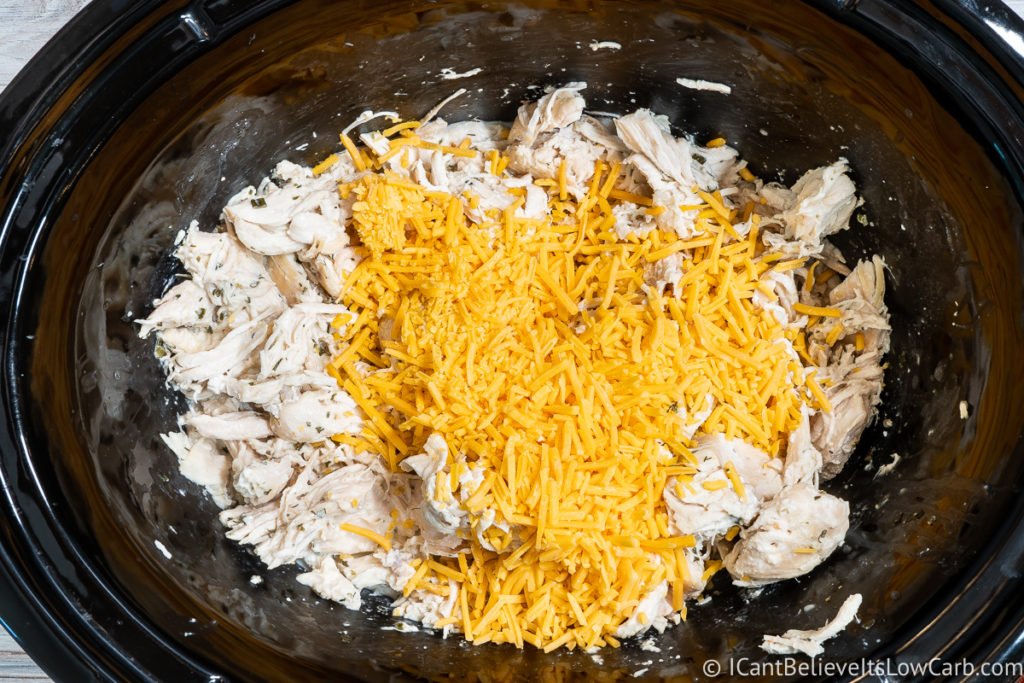 adding cheddar cheese to the pot