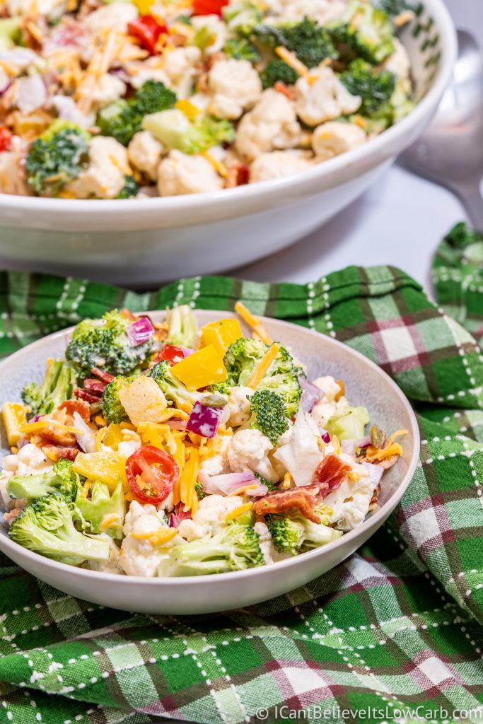 Bowl of Broccoli Cauliflower Salad on a green towel