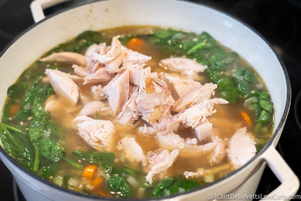 Adding chicken to the soup