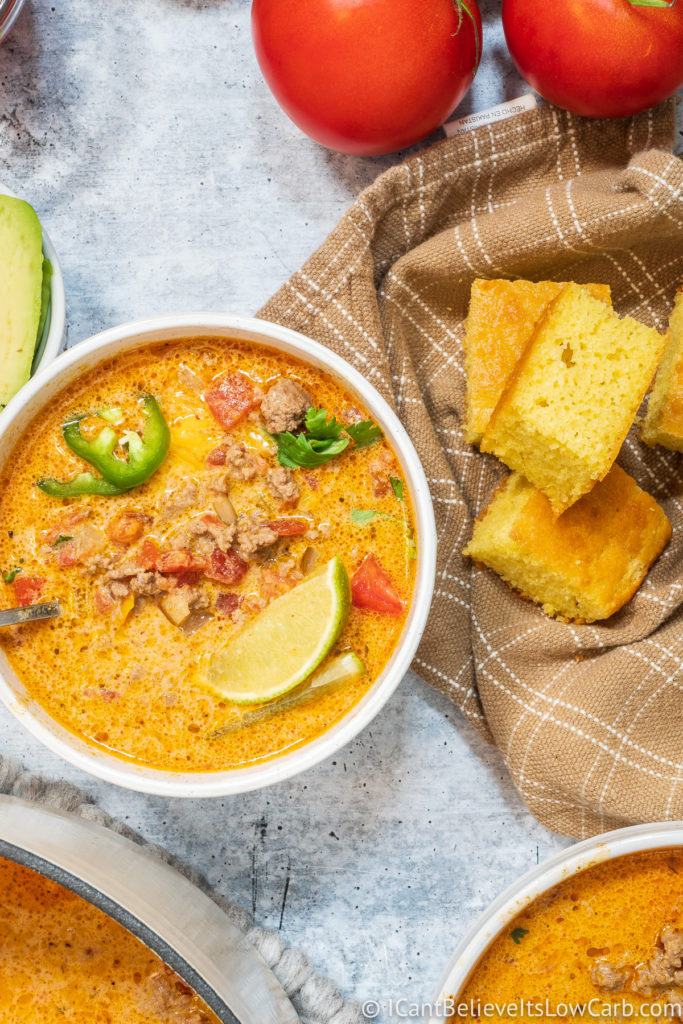 Bowl of Keto Taco Soup with cornbread on the side