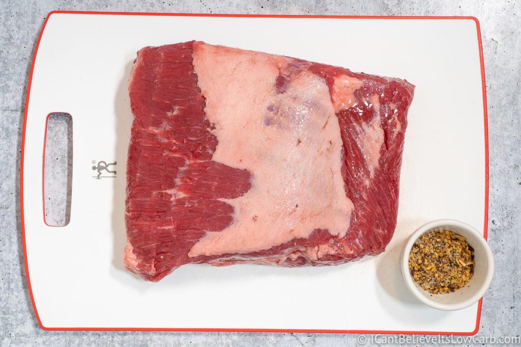 Raw Corned Beef on a cutting board